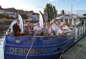 Captain and guests at the bow of the Luxury Barge the Deborah