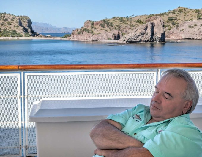 Chef Dennis sleeping on the rear deck of the safari endeavour