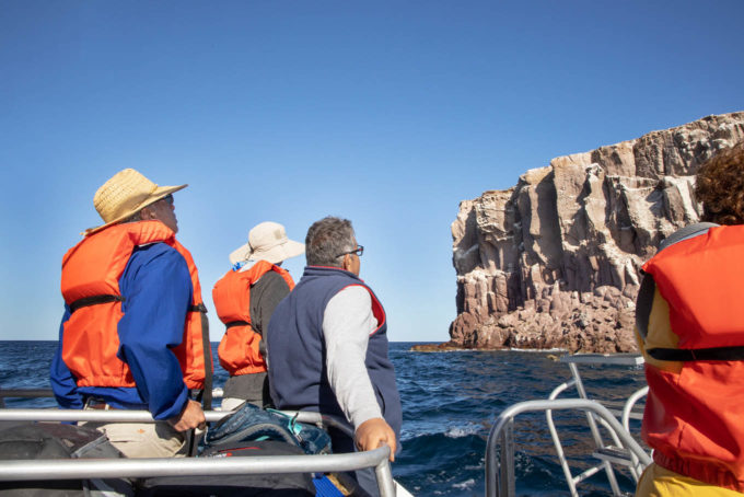 people on board a skiff in the sea of cortez
