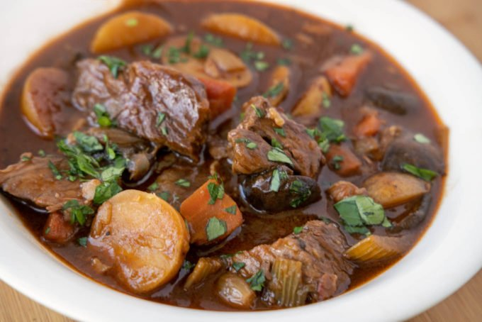 white bowl of guinness beef stew