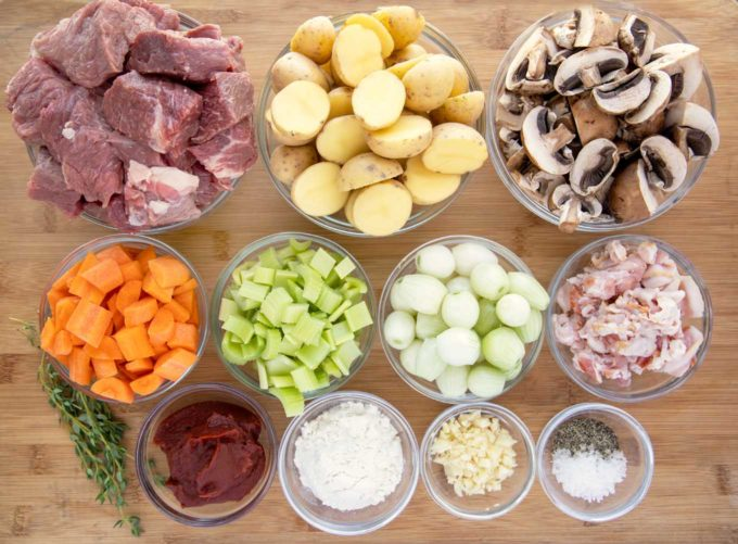 ingredients in glass bowls to make Guinness beef stew