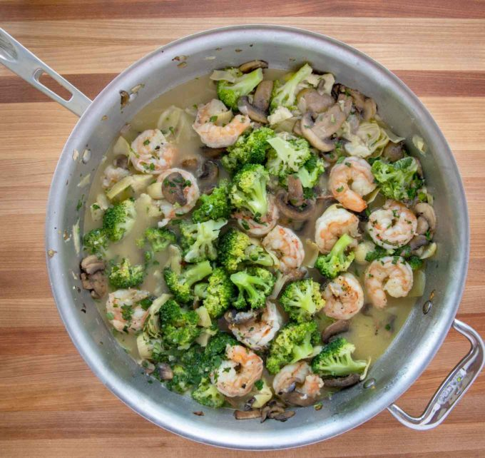 finished shrimp and broccoli in a saute pan