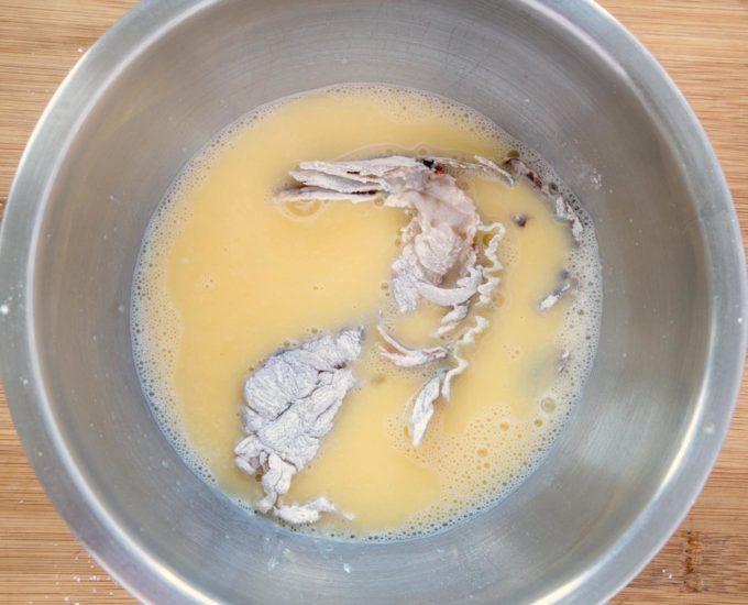 floured lobster tails in eggwash