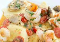pinterest image for shrimp and ravioli scampi