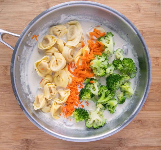tortellini broccoli and carrots added to the cream mixture