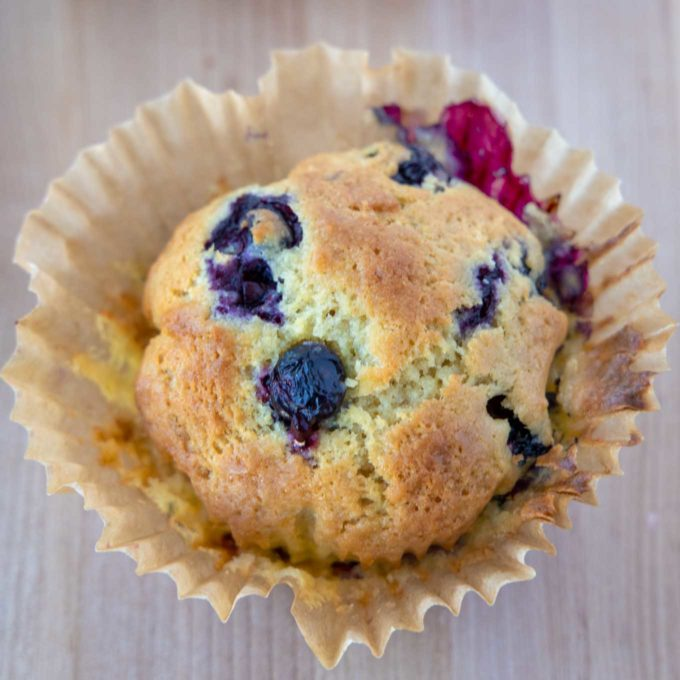 Blueberry Muffin with paper pulled away from muffin