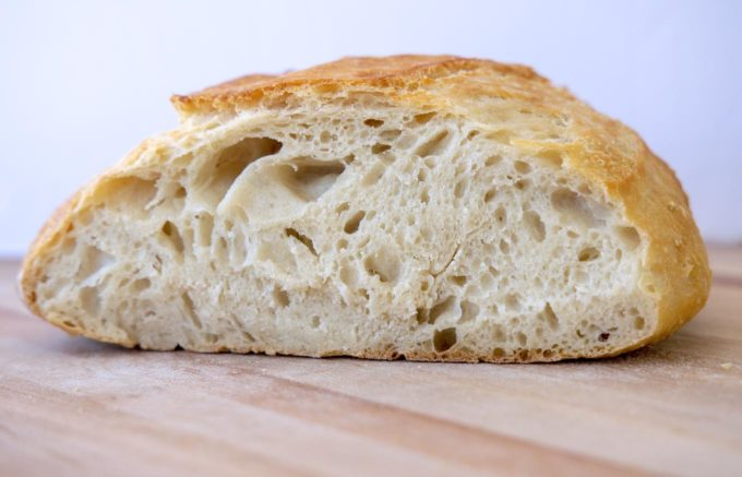 side view of cut loaf of homemade artisan bread