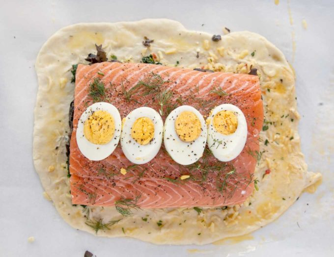 slices of hard cooked egg on top of the seasoned salmon layer of the Coulibiac of Salmon