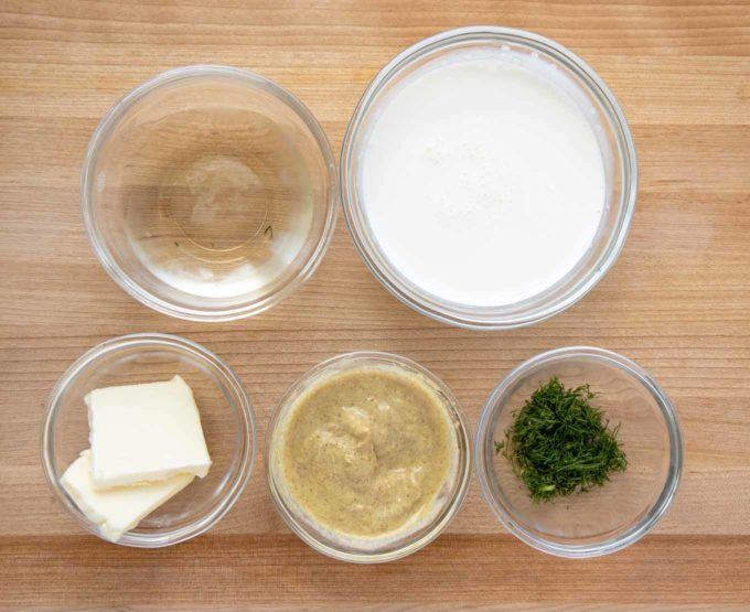 overhead view of ingredients to make dijon dill sauce