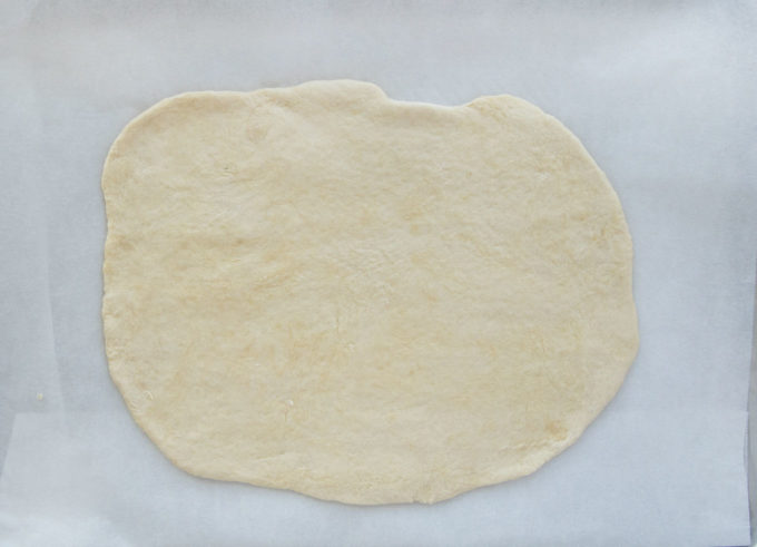 overhead view of rolled out puff pastry sheet