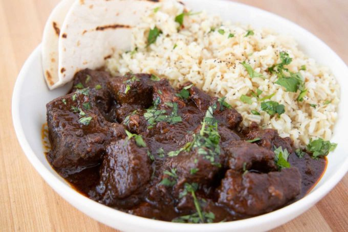 close up of beef Colorado and rice in a white bowl
