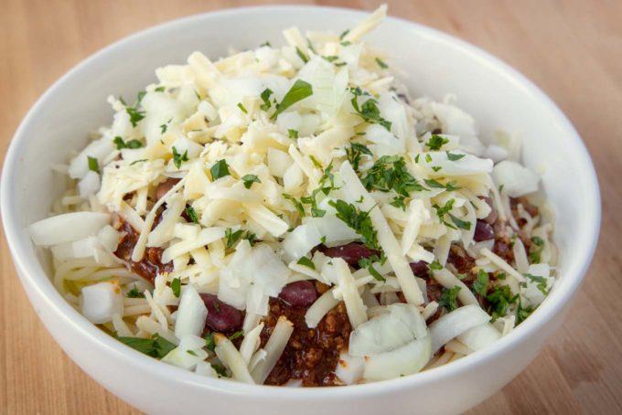 close up of Cincinnati chili five ways in a white bowl