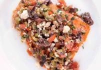 mediterranean style salmon on a white plate