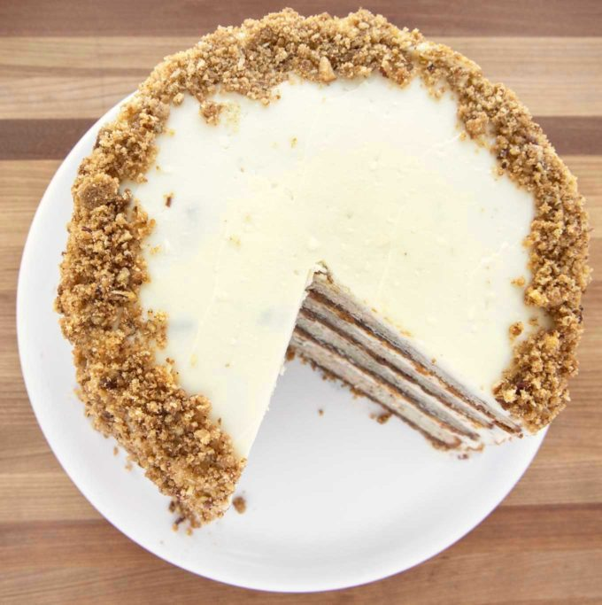 overhead view of banana crunch cake with ¼ of the cake cut out