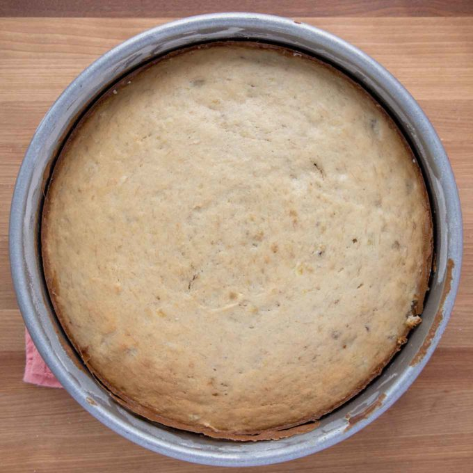 golden brown banana cake in cake pan