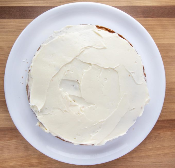 layer of banana cake frosted with cream cheese frosting