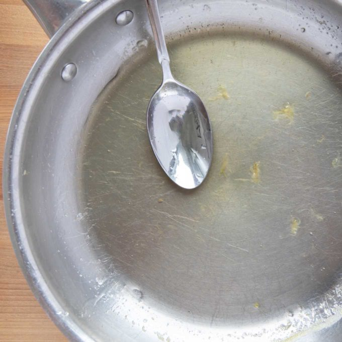 lemon syrup and a spoon in a saute pan