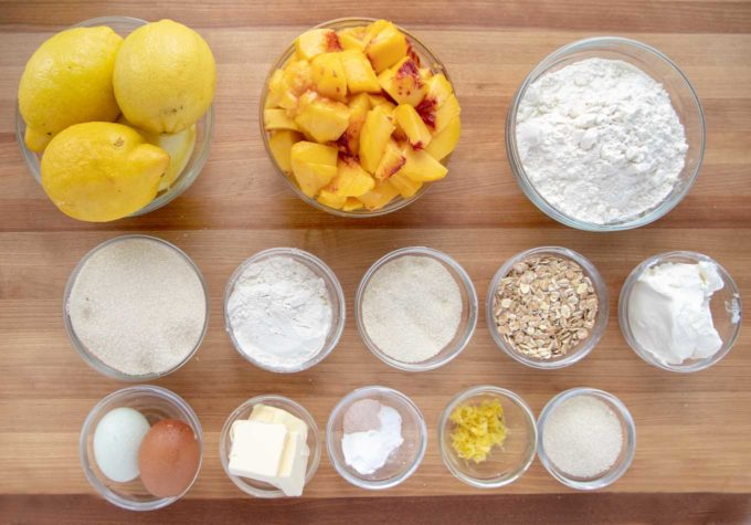 overhead view of ingredients to make a peach buckle in glass bowls