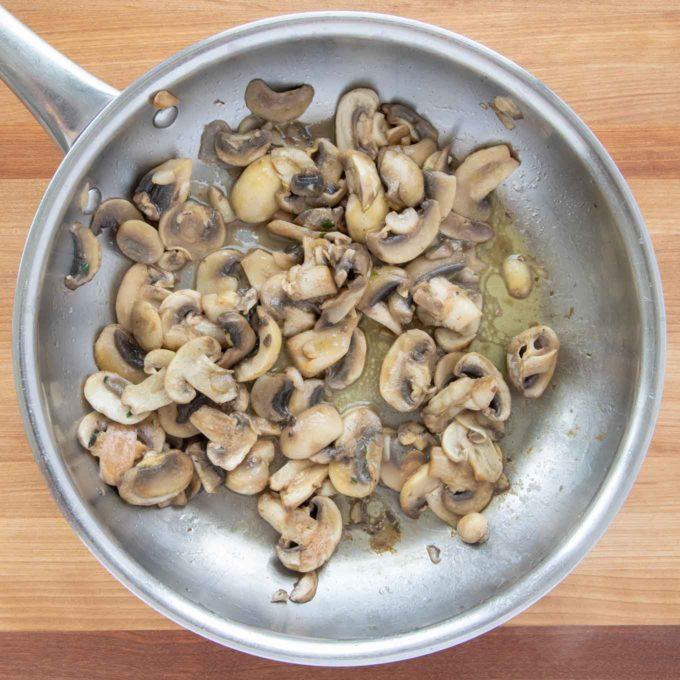 cooked sliced mushrooms in a saute pan