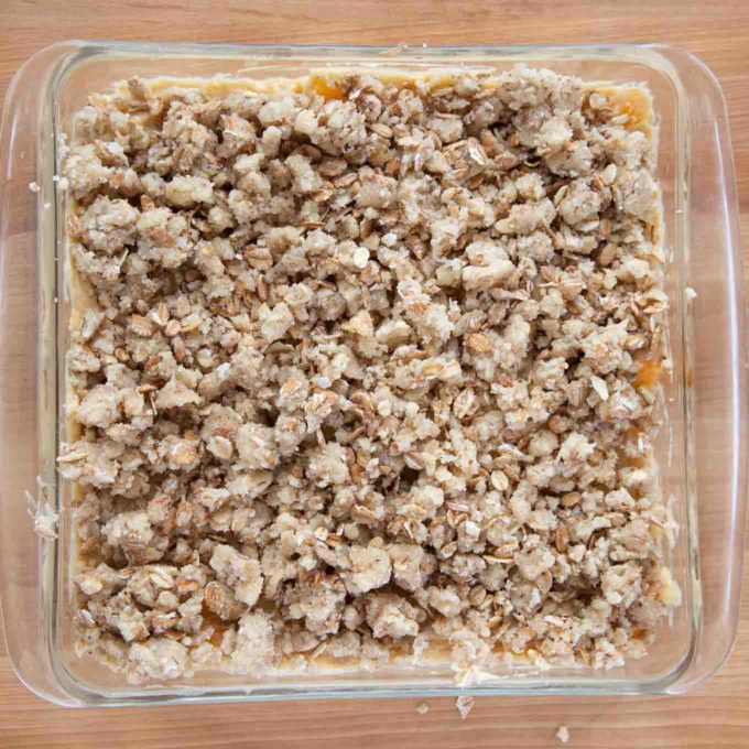 cake in a glass baking dish topped with streusel topping