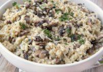 mushroom risotto in a white bowl