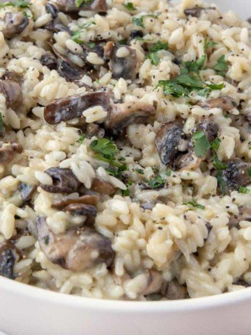mushroom risotto in a white bowl