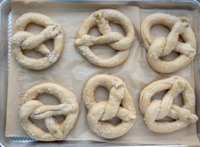 salted raw beer pretzels on a baking sheet