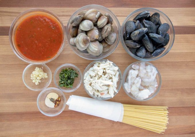 overhead view of ingredients in bowls to make seafood marinara