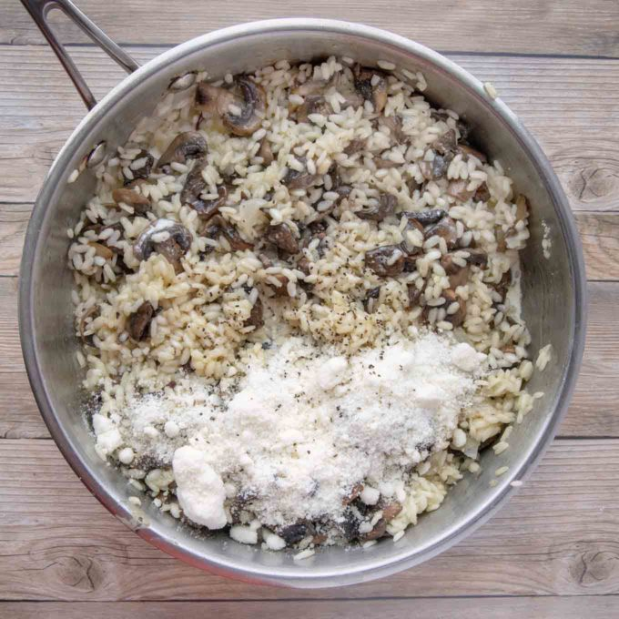 add romano cheese and cream to the pan of mushroom risotto