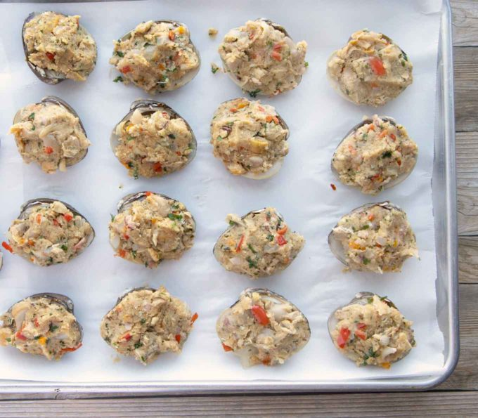 stuffed uncooked deviled clams on a sheetpan