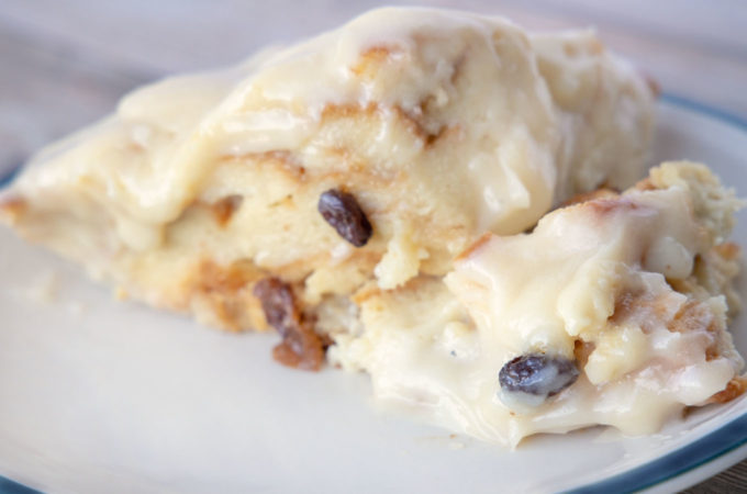 bread pudding with cream cheese frosting on a plate
