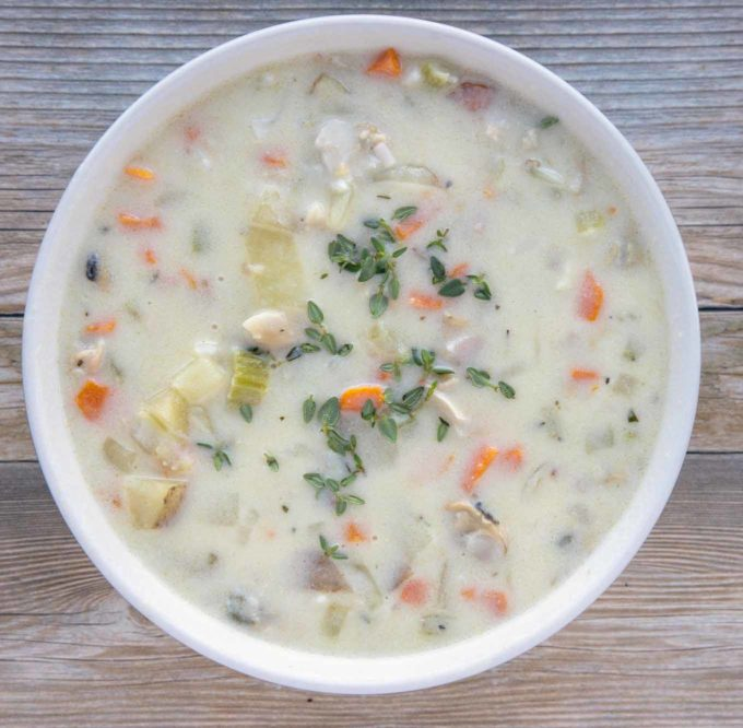 overhead view of New England clam chowder in a white bowl
