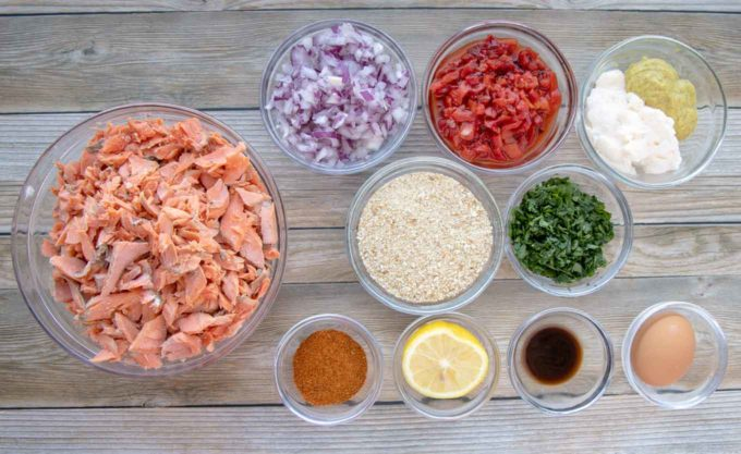 ingredients to make salmon cakes in glass bowls