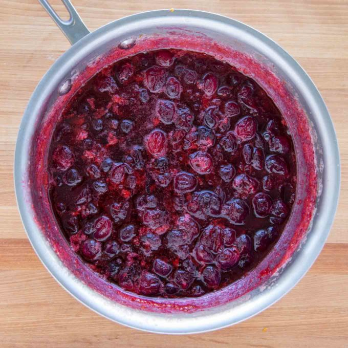 cranberry sauce simmering in a saucepan