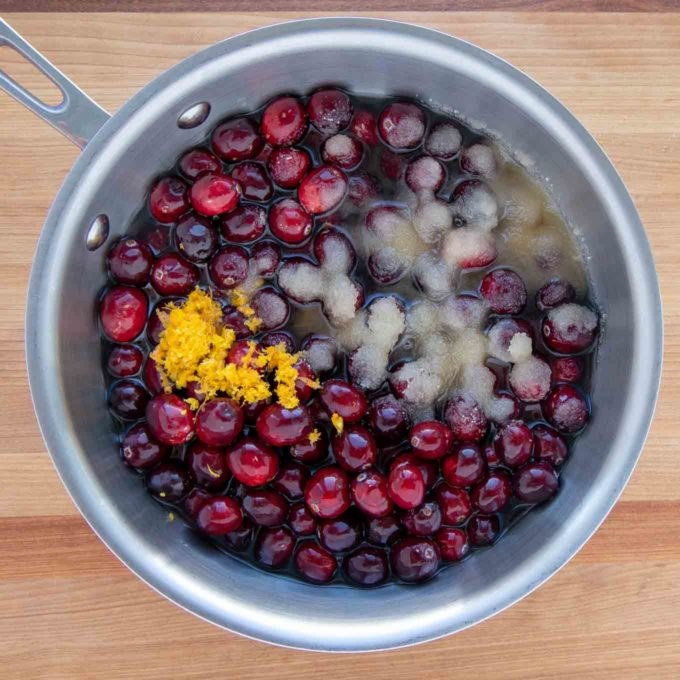 ingredients to make cranberry sauce is a sauce pan