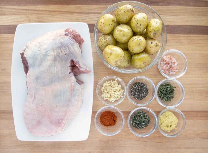 overhead view of ingredients to make oven roasted leg of lamb and potatoes
