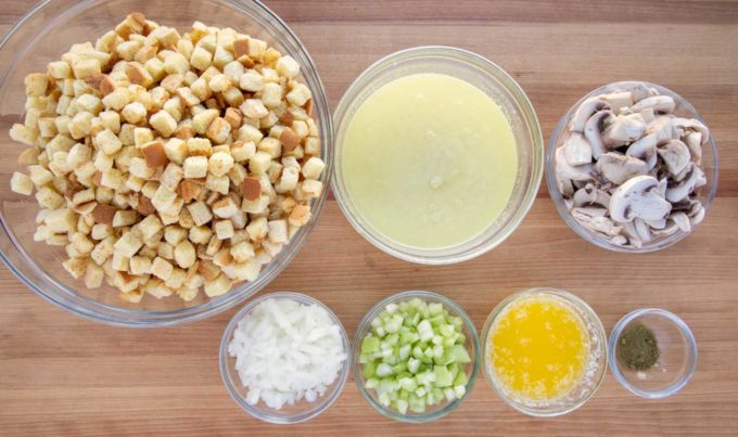 ingredients to make potato bread stuffing in glass bowls