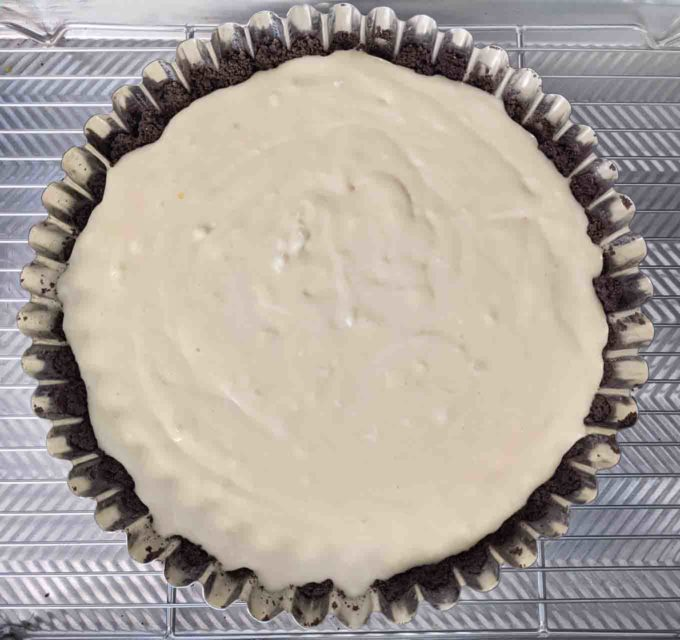 unbaked cheesecake in chocolate crust