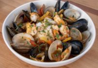 seafood stew in a white bowl