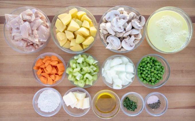 ingredients to make chicken stew in glass bowls