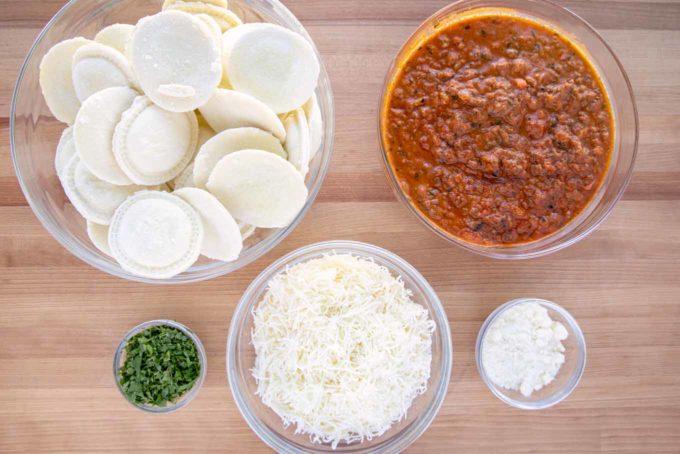 ingredients to make ravioli lasagna in glass bowls