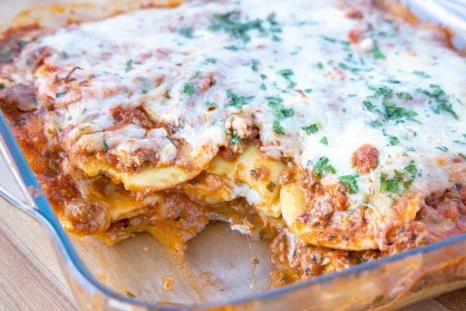 pan of ravioli lasagna with a piece cut out
