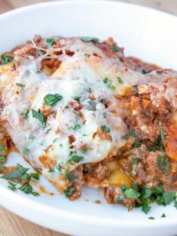 serving of ravioli lasagna in a white bowl