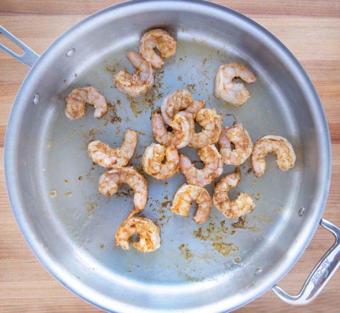 shrimp cooking in a large skillet