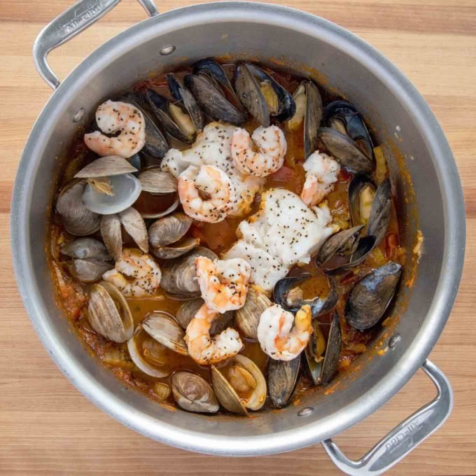 fully cooked seafood stew in pot