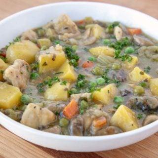 chicken stew in white bowl