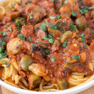 vegetarian sauce over pasta in a white bowl