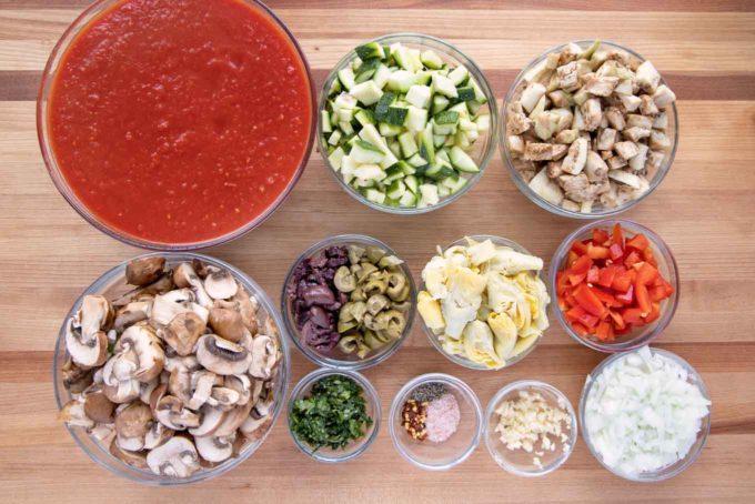 ingredients to make vegetarian pasta in glass bowls