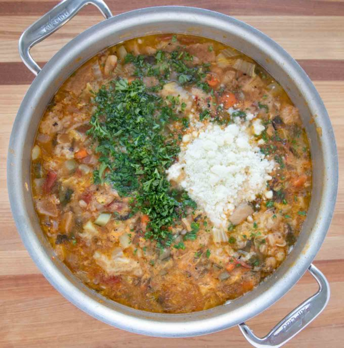 cheese and parsley added to stock pot of Tuscan Bread Soup