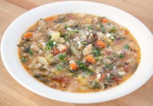 side view of Tuscan bread soup in a white bowl
